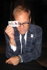 Alton Brown holds up a Metro Library Network library card.