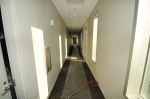 Light filters into this third floor hallway on the way to the LivingLearning Roof and Auditorium.