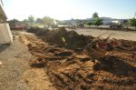 The parking lot will be paved soon, now that the underground drainage systems are in place.